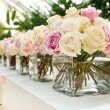 wedding buffet table flower decorations-small white flower in a row